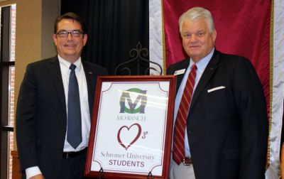 Charlie McCormick, president of Schreiner University, and Dick Powell, president and CEO of Mo-Ranch
